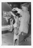 Howard and Vim install prison warden's license plate, 1946