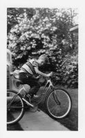 Brent McMaster and bicycle, ca. 1950.